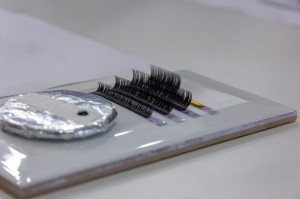 Selective focus Eyelash Extension tools on tile.Artificial lashes